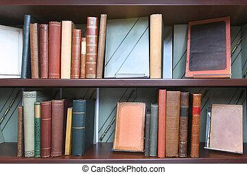 Vintage book shelf - Old book shelf with stacks of vintage...