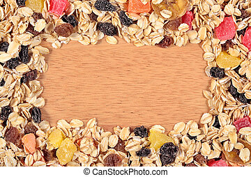 Frame of musli on a wooden background