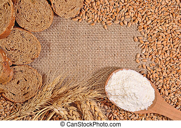Frame of white flour, wheat and bread
