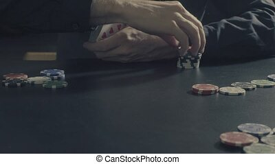 Poker game. Man's hands dealing cards and chips - Poker game...