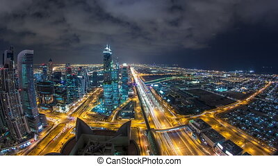 Dubai business bay towers illuminated at night timelapse....