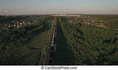 Train running in the village, aerial view - Aerial view of...