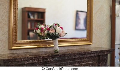 Bridal bouquet near mirror indoors