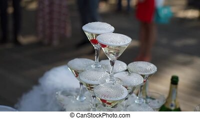 Pyramid of champagne on party outdoors