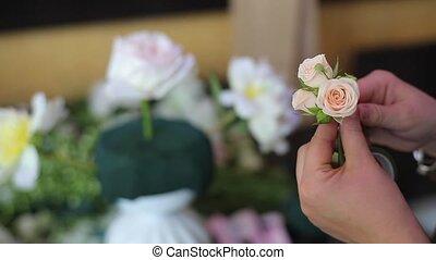 Florist making flowers composition closeup