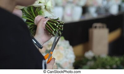 Florist working with roses flowers