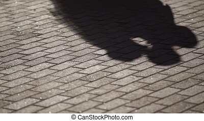 Lovely couple kissing shadow on ground