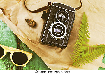 Old retro camera with sunglasses abstract background - Old...
