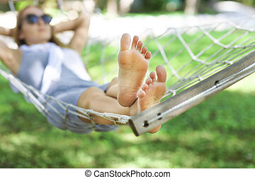 Lazy time. Woman in a hammock