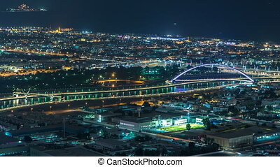 Dubai canal timelapse as seen during night with boats...
