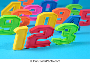 Colorful plastic numbers 123 on a blue background