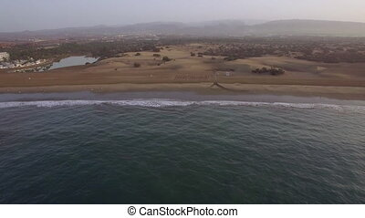 Flying over ocean, beach and sand dunes on Gran Canaria -...