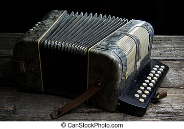 Old accordion with wine - Old accordion on rustic wood table...