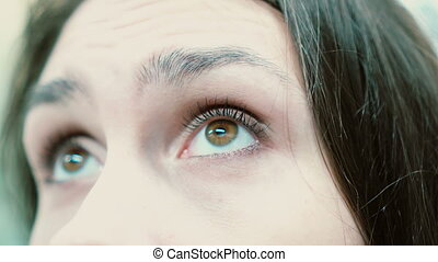 Close-up view of woman s eyes looking at the camera. -...