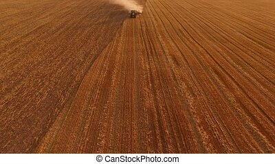 Tractor ploughing field, aerial view. Tractor, plow and...