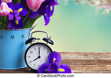 Spring time concept - retro alarm clock with flowers copy...