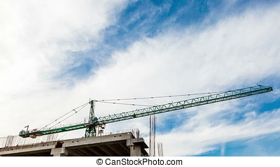 Timelapse from low angle of construction crane and moving...
