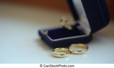 Three wedding rings on white background