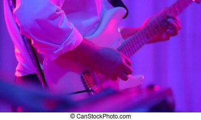 Man playing music on guitar