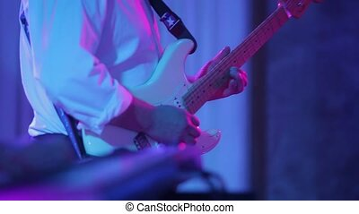 Man playing music on guitar at concert