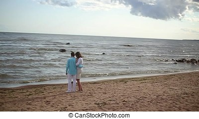 Young lovely couple embracing on a beach