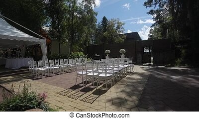 Wedding ceremony decoration outdoors at sunny day