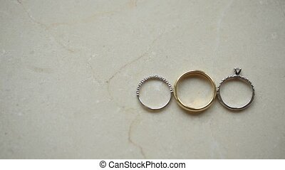 Three wedding rings on marble background