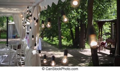 Outdoors garland party decoration at sunny day