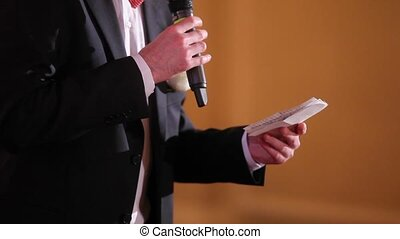Man speaking with microphone on a party