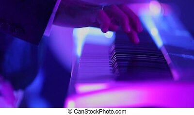 Man playing music on keyboard