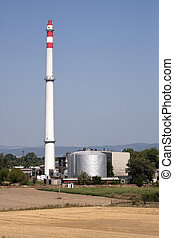 Smokestack and factory in fields