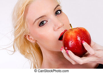 beautiful blond with apple