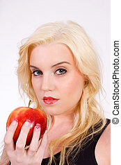 Blond woman with apple