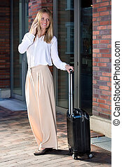 Pretty young woman with suitcase - Full length portrait of...