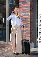 Pretty woman with black suitcase - Pretty blonde woman in...