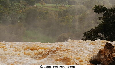 Vertex waterfall the falling water from a dirty yellow...