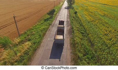 Truck near field. Nature and asphalt road. Basics of...