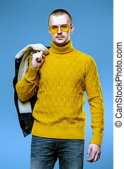 yellow pullover - Sexual male model posing in jeans clothes...