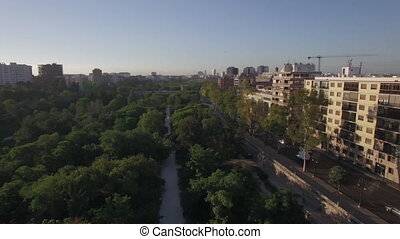 Street with park and traffic in Valencia, aerial view -...
