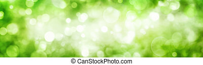Green foliage bokeh with shimmering highlights