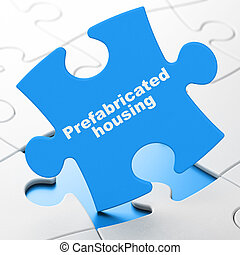 Construction concept: Prefabricated Housing on puzzle...