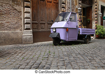 Rome, Italy Cobblestone street and a funny three wheeled car...