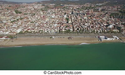 Aerial panorama of Barcelona with coast, Spain - Flying from...