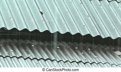 Rainy. - Drops of rain on the roof covered with slate.