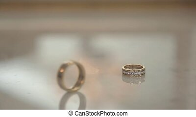 Two wedding rings rolls on white background