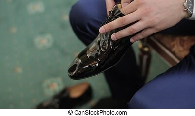 Man wearing black shoes closeup