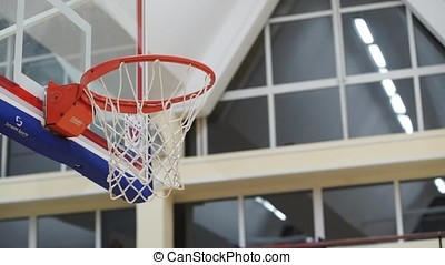 Basketball player throws the ball in the basket slowmotion