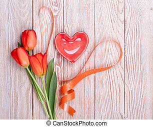 Red heart shaped valentine with tulips