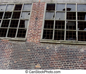 vandalism broken destroyed windows in industrial building