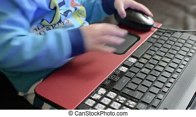 little boy on a  laptop - little boy playing on a laptop
